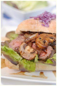 Summer Steak Sandwich  Ingredients:    4 buns  4 round steaks  lettuce  1 large onion  7oz mushrooms  3 tbsp soy sauce  1/2 tsp fresh ginger  1/2 garlic clove  pepper and salt  2 tsp brown sugar  1 tbsp mirin  1/8 to 1/4 tsp sesame oil  salt and pepper  pinch dried chili flakes (or cayenne pepper)  butter