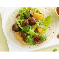 Tandoori lamb wraps recipe - By Australian Women's Weekly, Try these delicious Indian meatballs wrapped in a roti with spicy tandoori yoghurt sauce, fresh veggies and mango chutney.