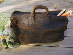 Vintage Doctor Bag, ANTIQUE, Black Cowhide Leather, Very Old and Very Worn, Make a House Call. $68.80, via Etsy.