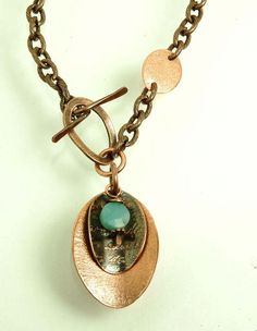 Textured, etched, and oxidized copper w/ Amazonite drop