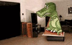 Optical illusion with a cut out dinosaur.