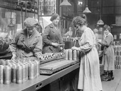Women munitions workers gauging the thickness of the heads of shells at Royal Shell Factory No.3, Woolwich Arsenal, May 1918.
