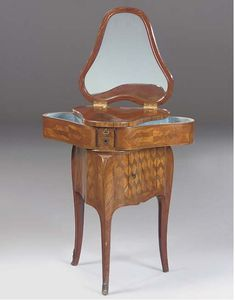 A FRENCH TULIPWOOD, KINGWOOD AND MARQUETRY COIFFEUSE  LATE 19TH EARLY 20TH CENTURY OF TRANSITIONAL STYLE  Of heart shaped outline, the hinged top inlaid with ribbon tied flowers and with a mirror on the reverse and with a sprung drawer to each side above cube parquetry panels with a tambour-fronted compartment to one side, on cabriole legs with sabot feet.