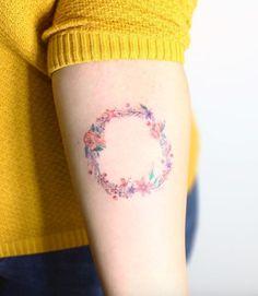 Circle Of Flowers Tattoo