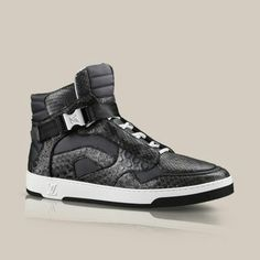 Louis Vuitton -  ON THE ROAD SNEAKER BOOT        Seen at Louis Vuitton's Spring/Summer 2014 men's fashion show, this cutting-edge sneaker boot comes in a graphic patchwork of python and calf leather. It is accessorised at the front and back with distinctive metal plaques, one of which is engraved with Louis Vuitton.  £1,170