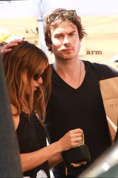 Ian Somerhalder leans in to his girlfriend Nikki Reed to plant a smooch on her head while browsing items at the Farmers Market together on Sunday morning (August 17) in Los Angeles.