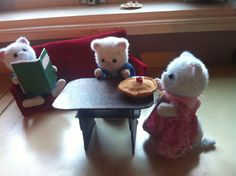 Mum,dad and son sylwanian cats with table,sofa,book and cake made by me ;) it looks do sweet!