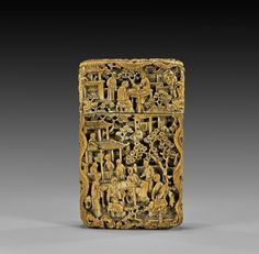 """ANTIQUE CARVED IVORY CARD CASE Antique Chinese carved ivory calling card case; of rectangular form, with continuous densely figural scenes: of scholarly gatherings and chess games in garden settings, and of men rowing boats about town; 19th Century or earlier and displaying a lovely patina; H: 4 1/8"""""""
