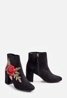A velvet bootie featuring an inner zip closure and embroidered star design....