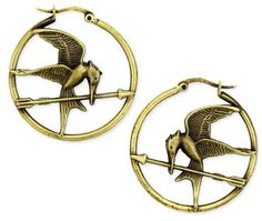 Would it be incredibly tacky to have every piece of Hunger Games jewellery adorning my person?