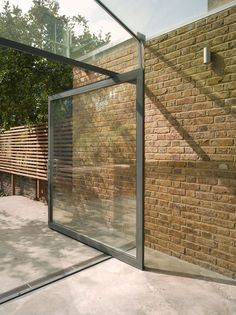 in Hackney: it's week four in our celebration of design from the London borough of Hackney and today's featured project is a modest glass extension to a house in Dalston by Shoreditch-based architects Platform London Architecture, Architecture Design, Orangerie Extension, Glass Extension, Side Extension, Extension Ideas, Brick Garden, Pivot Doors, London Property