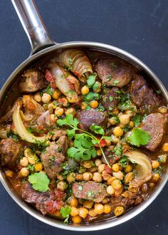 Lamb Stew with Chickpeas! Spicy and warm. Perfect winter comfort food. Cinnamon, cumin, coriander, and a hit of cayenne.