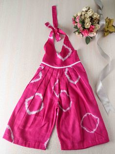 This Tie n Dye Halter Dress in Mulmul is perfect for any little girl. Buy more such dress for your little one @RedPolka