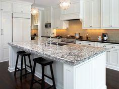 Large White Kitchen using Cream Glass subway tile on backsplash tile. https://www.subwaytileoutlet.com/products/Cream-Glass-Subway-Tile.html#.VUvIOiFViko