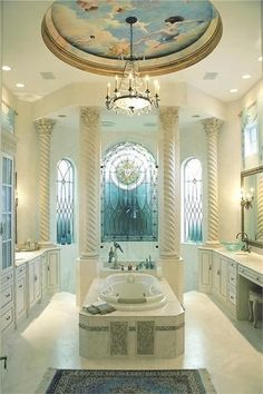 Luxury bath...very clean and elegant. Good use of columns, lead eye up to the tall ceiling.
