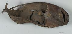 Leather Shoe with Gilded Medallions Object Name: Shoe Date: 2nd–9th century Geography: Egypt, Akhmim (former Panopolis) Culture: Coptic Medium: Leather; gilded Dimensions: 9 3/4 in. long (24.7 cm long) Classification: Leather Credit Line: Gift of George F. Baker, 1890