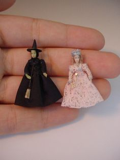 These two tiny witches from the Wizard of Oz are made from china-painted porcelain.