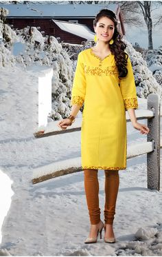 Yellow color pure cotton Fabric Kurti. Contrast placket patch with fancy fabric buttons decked completes the look.  For orders contact +919870725209 or Whtsapp