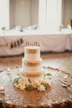 White wedding cake brushed with metallic gold | Photo by Shaun Menary