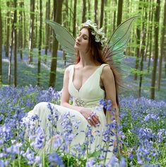 Fairy in Bluebells By Violaine Villota ~~~~~~~~~~~~~~~ Wings here! http://www.fancyfairy.com/titaniawings.html #fairy #green #forest #Halle