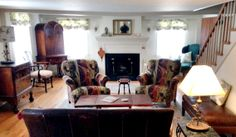 The Inn Living Room. Guests relax by the fire and enjoy the light flooding in through the windows. www.morninggloryinnmaine.com