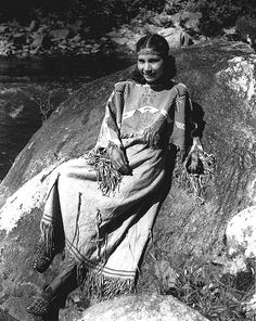 Mrs. June Welch, a Cherokee Indian, in traditional clothing. Photo taken at the Great Smoky Mountains National Park, Tennessee, 29th May, 1939. TSLA