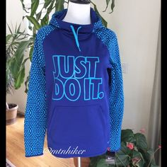 "Nike Fleece Lined Hoodie Beautiful royal blue & turquoise colors! Funnel neck; drawstring hood; pullover style Front kangaroo pocket  thumb hole sleeves  Chest 41""; bottom opening 40""; length from shoulder 25""  NWT. Smoke free home  Nike Tops Sweatshirts & Hoodies"