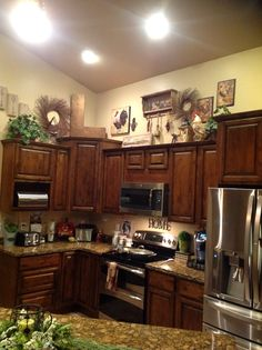 i love decorating the tops of kitchen cabinets above cabinet decor decorating above kitchen