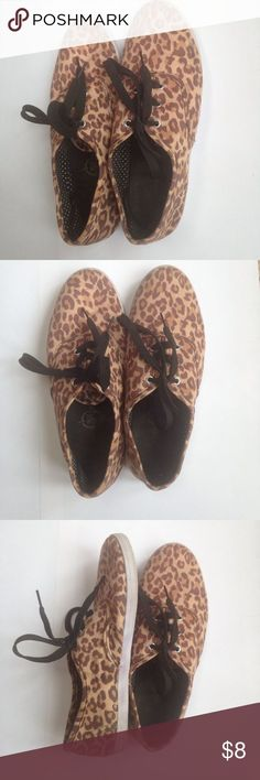 Animal print sneakers These leopard print shoes are so fun!! They are gently worn and in great shape. They lace up. There is a small black mark on the right shoe and a tiny hole on the tongue of the shoe but it isn't noticeable at all. Size 7/8 Shoes Sneakers