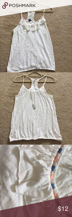 Tank top Embroider detail with ruffle. Lace up tie on back. The end of the ties have tiny bells on them. Cinched hem. Worn once. 60% cotton, 40% modal. American Eagle Outfitters Tops Tank Tops