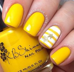 Simple and cute looking yellow nail art design, a combination of matte and striped designs. The stripes are composed of white and yellow nail polish with star shaped silver dust polish on top.