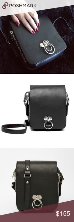 UNIF black leather VAULT o-ring bag In excellent condition. Sold out everywhere. Bought from the UNIF website a few years ago UNIF Bags Crossbody Bags