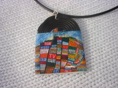 radiohead 2 in 1 vinyl record miniature charm on black rubber necklace.