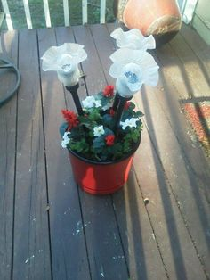 A refurbished old pot and globes from a ceiling fan up cycled.  Solar lights make it beautiful on a deck at night