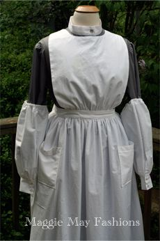 WWI era nurse's uniform - loose apron, sleeve protectors, cuffs and collar - so that they could be washed every day and have pristine white and clean and tidy appearance... without needing to wash the whole attire