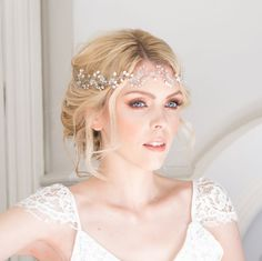 The beautiful handmade Fern bridal hair vine is an exquisite statement piece made with Swarovski crystal and the finest freshwater pearls, entwined and suspended amongst Gold or Silver plated wire. Bohemian inspired wedding headpiece designed & handmade in the UK by British bridal designer Rachel Chaprunne It is flexible and can be worn asymmetrically along loose curls, positioned along the curve of a romantic upstyle or woven into braided hair.