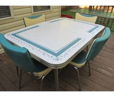 (Wow! The dinette set. Ours most often had a gray stone-looking pattern on the table with yellow chairs. I would like to have this one with a kitchen big enough for it.) Turquoise Patterned Formica Dinette Set