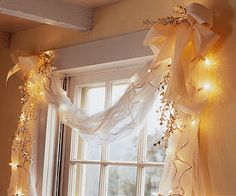 Last Minute Speedy Christmas Decorating- Pretty Panes. Swaddled in cheesecloth, white tree lights give off a diffused glow. Swag the cloth over a window frame, then festoon the corners with satin ribbon and silver foliage. Noel Christmas, All Things Christmas, Winter Christmas, Christmas Lights, Christmas Crafts, Simple Christmas, Holiday Fun, Holiday Decor, Xmas Decorations