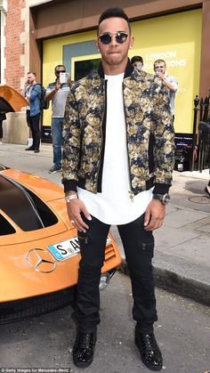 Floral fashion: In £845 Christian Louboutin sneakers and a £349 Oliver Spencer bomber jacket