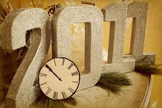 New Year - neat idea for a centerpiece... glittered numbers would be cheap, easy and COOL!