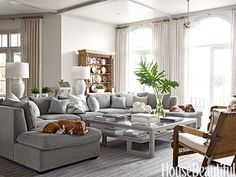 A big family room demands a big sectional, this one is covered in plush Glant Island chenille, in one of dozens of shades of gray designer Marshall Watson used throughout this Naples, Florida, house.