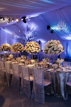 For a winter wonderland wedding, blue lighting creates a chilled effect.