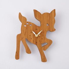 This fawn clock would be a sweet addition near the desk, and also brings in a nice warm wood tone.