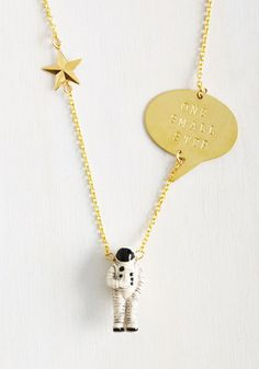 Feel like getting away for a little while? Slip this golden necklace around your neck and spend the day hanging solo! The astronaut pendant of this piece will help you navigate new spaces as its printed plate reminds you that one small step is all it takes to start your own odyssey!