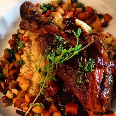 Moroccan-braised lamb shank with dried fruit & roasted almond couscous. Must cook this soon!