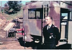 A officer standing outside a Logistical Command Truck while serving in Italy