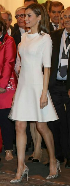 Queen Letizia - White fit-and-flare dress by Hugo Boss (Kajuni dress from the label's HUGO line). Lidia Faro python skin clutch bag and on her feet she wore the Magrit 'Mila' snake-effect pumps.