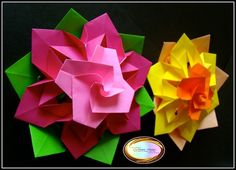 Learn how to make these beautiful origami flowers at.....Aprende a hacer estas lindas flores de origami ke se veran perfectas komo centro de mesa en..... http://origamimaniacs.blogspot.jp/2013/05/beautiful-origami-flower.html