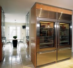 house interior with tile flooring idea and hallway seating with black table andarmchairs and glass front refrigerator residential in big size See Through Refrigerator, Glass Front Refrigerator, Subzero Refrigerator, Glass Fridge, Full Fridge, Kitchen Refrigerator, Refrigerator Freezer, Luxury Kitchens, Home Kitchens
