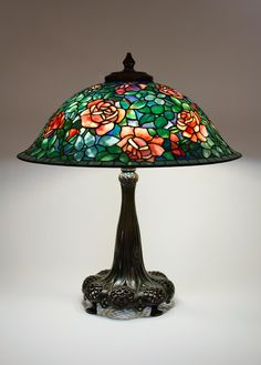 """Tiffany Studios, New York, Favrile Leaded Glass and Patinated Bronze """"Rose"""" Lamp."""